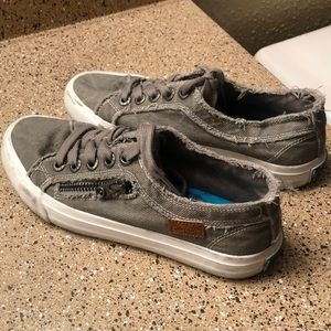 Distressed grey sneakers